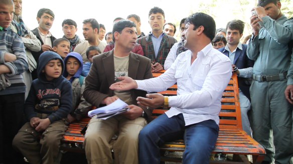 Performing an Improvised Drama in a Public Park in Afghanistan (by Edmund Chow)